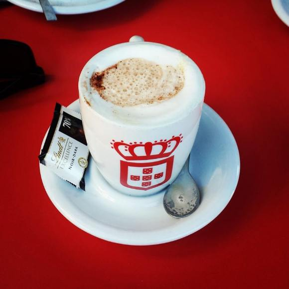 Drink a cappuccino at Vida that came with a piece of Lindt chocolate